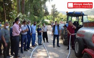 Hatay'da yangınlara karşı mahalle muhtarlarına su tankı dağıtımı